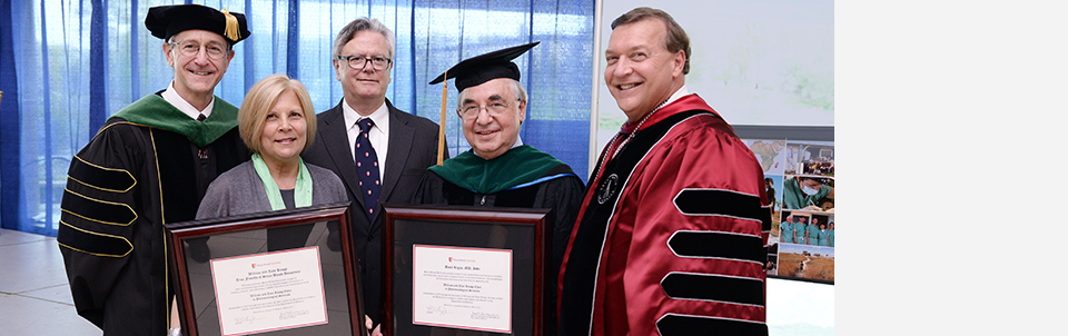 Dr. Basil Rigas receives Stony Brook's highest academic honor; Benefactors William and Jane Knapp recognized